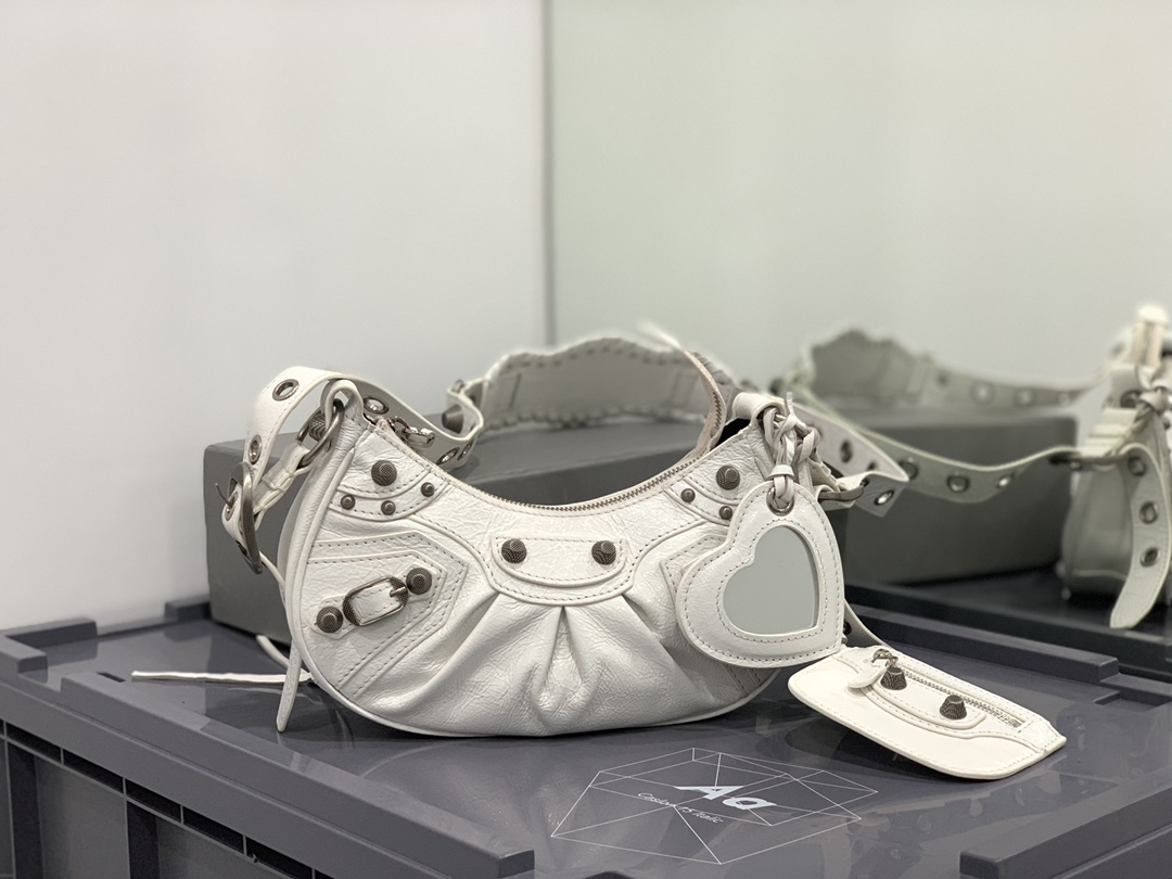 2021 Balenciaga Womens Le Cagole Small Shoulder Bag in White Arena Lambskin and aged Silver Hardware