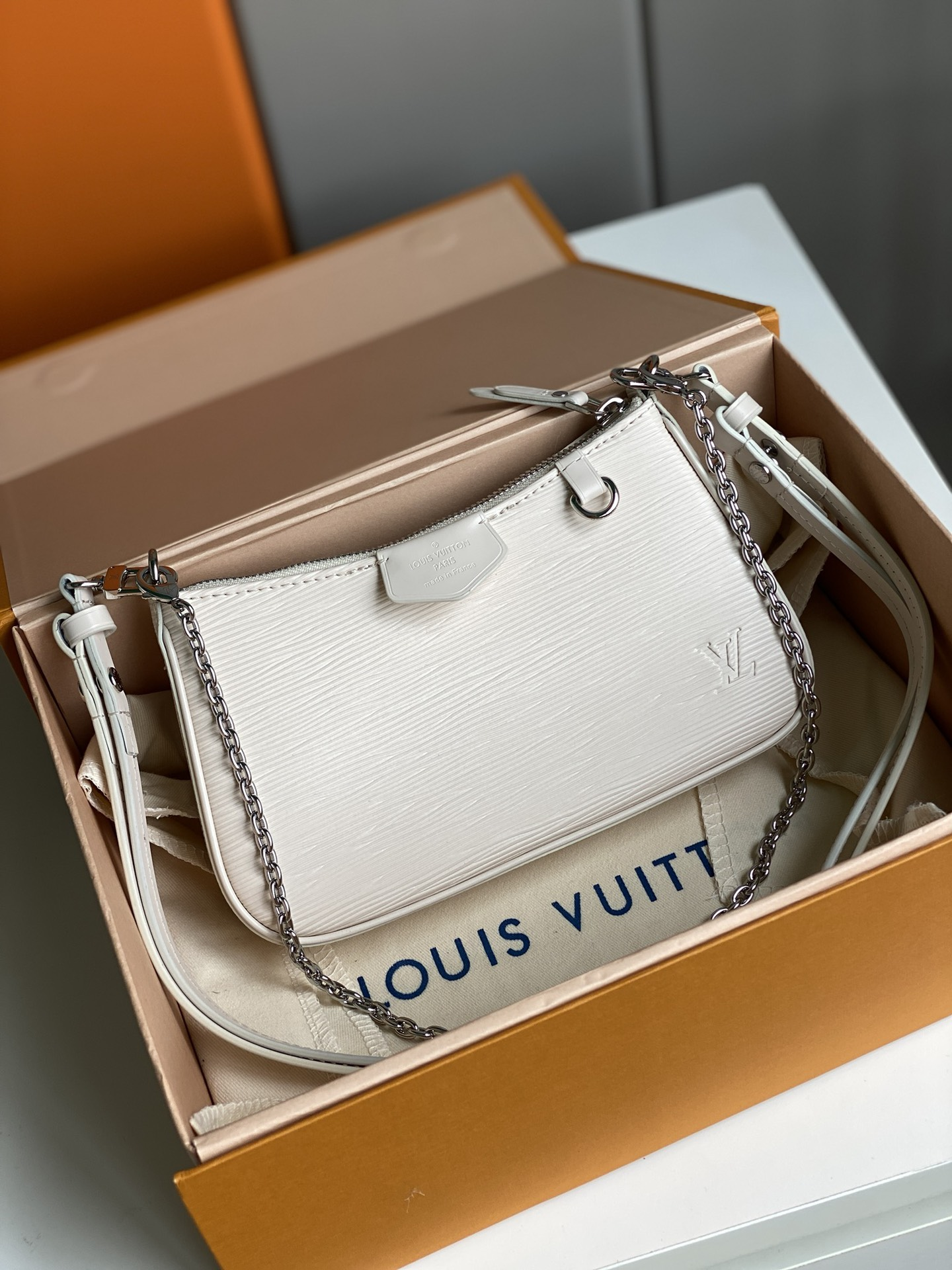 Replica Louis Vuitton Easy Pouch On Strap Epi Embossed Supple Grained Cowhide Leather White