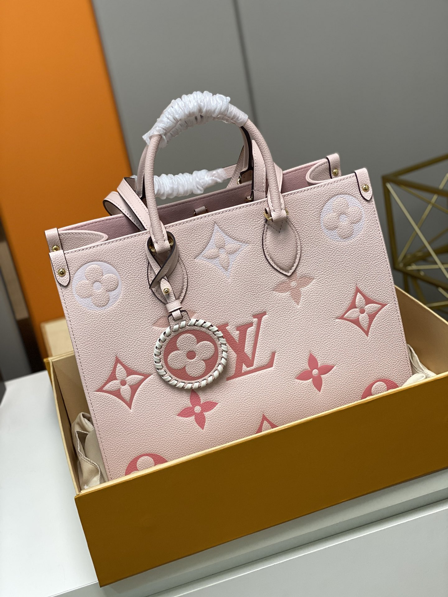 Replica Louis Vuitton M45595 Onthego PM Embossed Grained Cowhide Leather Pink