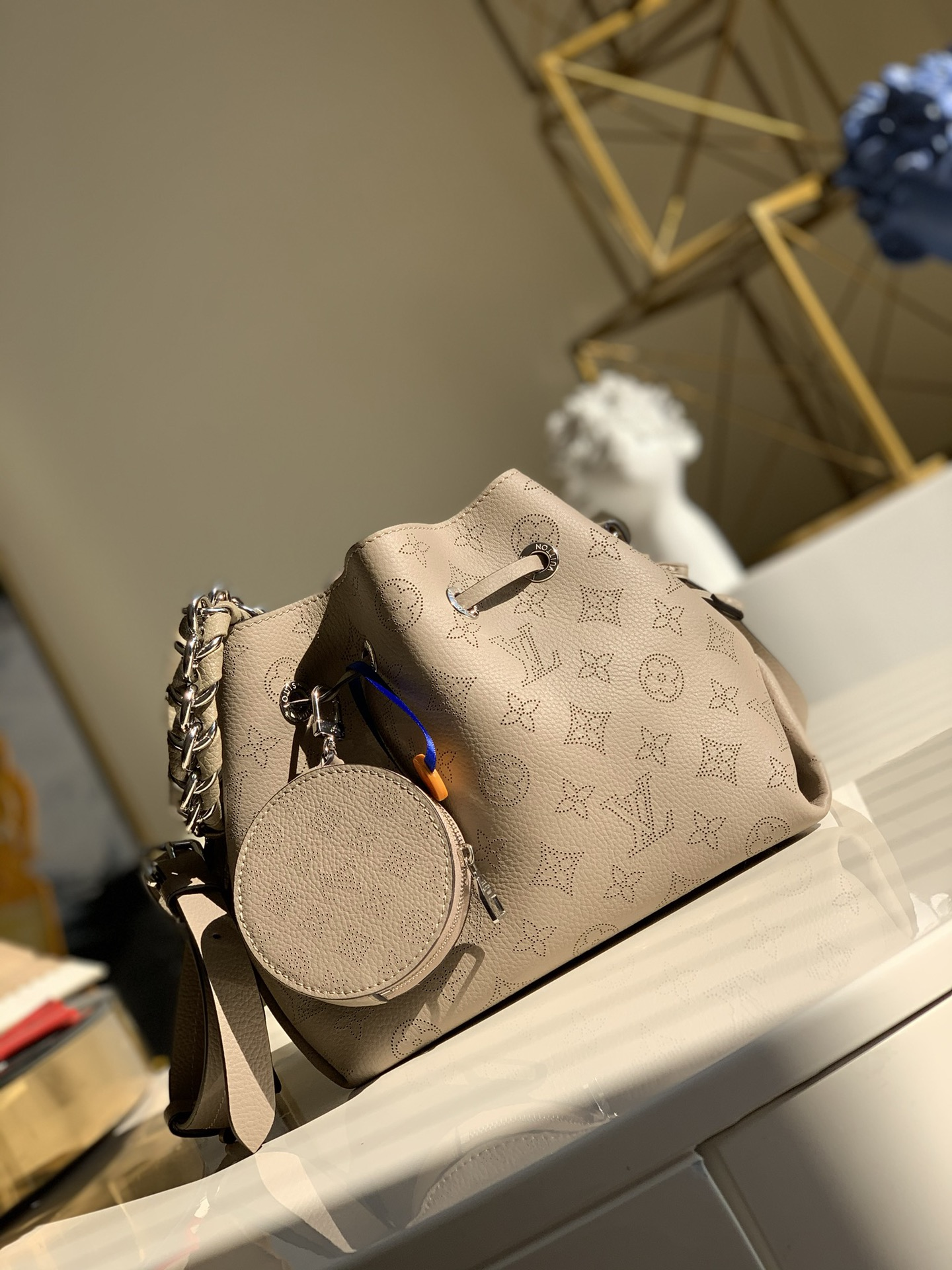 Replica Louis Vuitton M57201 Bella Bucket Bag in Mahina Calf Leather wite Perforated Monogram Pattern Galet