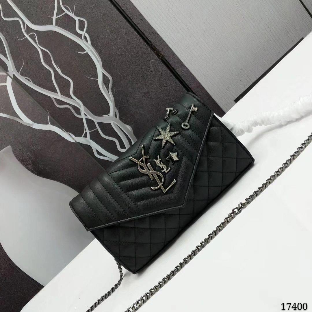 Saint Laurent Chain Wallet In Black Testured Mixed Matelasse Leather